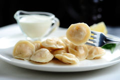 Dumplings with sour cream Stock Images