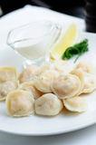 Dumplings with sour cream Stock Image
