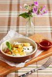 Dumplings with sour cream and baked apples Stock Photo