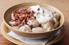 Dumplings with sour cream and crackling Stock Photos