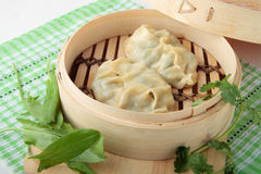 Dumplings of wheat flour in bamboo steamer Royalty Free Stock Image
