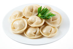 Dumplings on white plate isolated Stock Image