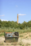 Dumpster and chimney Royalty Free Stock Photos