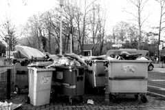 Dumpster full with garbageon French street Royalty Free Stock Photography