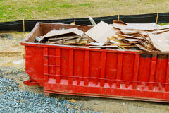 Dumpster with industrial waste isolated on white background. Stock Photo