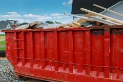 Dumpster with industrial waste  on white background. Stock Image