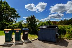 Dumpsters being full with garbage Royalty Free Stock Photography