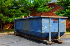 Dumpsters being full with garbage in a city. Royalty Free Stock Photos