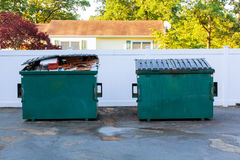 Dumpsters being full with garbage Stock Photos