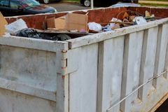 Dumpsters being full with garbage Royalty Free Stock Image