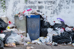 Dumpsters being full with garbage. In the evening Stock Images