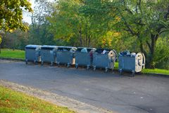 Dumpsters by the walking path Royalty Free Stock Image