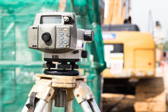 Dumpy automatic level instrument with construction site backgrou Royalty Free Stock Photo