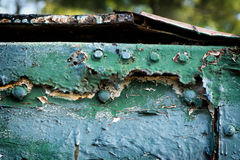 Dumpy Dumpster. A detailed close up macro photograph of cracked and peeling painted dumpster. A great texture image for a background or overlay stock photo