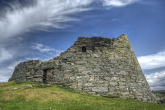 Dun Carloway Broch, Isle of Lewis. View of ancient dwelling place called a broch at Carloway, Isle of Lewis, Scotland, photographed against bright blue summer Royalty Free Stock Photo