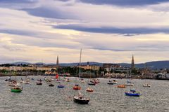 Dun Laoghaire. Boats in Dun Laoghaire Harbour Dublin Bay, Ireland with Dun Laoghaire town in background Royalty Free Stock Photos