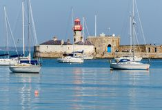Dun Laoghaire harbour with its Victorian lighthouse on the coast of County Wicklow in Ireland on a calm spring morning stock image