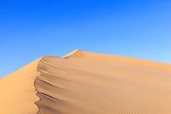 Duna de areia no nascer do sol no deserto Imagens de Stock Royalty Free