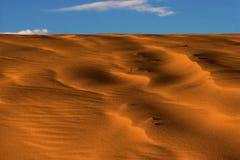 Duna de arena en la puesta del sol Imágenes de archivo libres de regalías