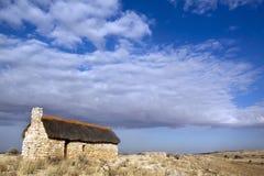 Duna e mulino a vento rossi della Kalahari Fotografie Stock