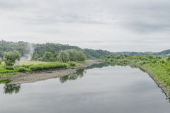 Dunajec River. In small village Rożnów  in Poland . View from the foodbridge on river and mountains with forest Stock Photos