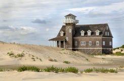 Dunas de arena, casa del ahorro de vida, baterías externas Fotos de archivo