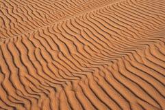 Dunas de arena en la puesta del sol Imágenes de archivo libres de regalías
