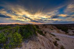 Dunas de arena en la puesta del sol foto de archivo libre de regalías