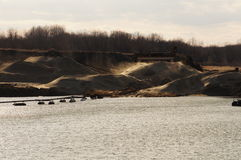 Dunas de arena industriales con la arena soplada por el viento Imagen de archivo libre de regalías