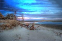 Dunas de arena de la playa en la puesta del sol Imagenes de archivo