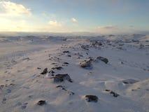 Dunas de la nieve y del hielo en la orilla del lago Erie en la puesta del sol, parque de estado de la isla de Presque Foto de archivo