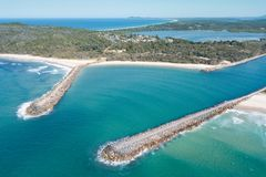 Dunbogan to Diamond Head. How many sailors have been happy to see the breakwalls at Camden Head? They also offer protection to swimmers at Pilots beach Stock Images
