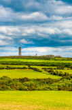 Dunbur Head. Wicklow Head Lighthouse has safeguarded the scenic Wicklow coastline since 1781. It is a peace seeker`s haven with inspiring and refreshing views of Royalty Free Stock Image