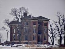 Duncan Manor dans la neige crépusculaire et en baisse image libre de droits