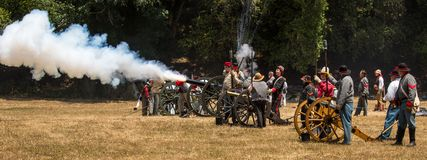 Confederate soldiers fire canon Royalty Free Stock Image