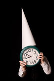 Dunce cap and clock Royalty Free Stock Images