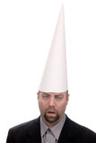 Dunce cap on man Stock Images
