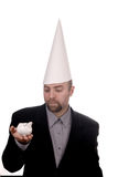 Dunce cap and piggybank Stock Photos