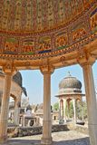 DUNDLOD, RAJASTHAN, INDIA - DECEMBER 27, 2017: General view of a well with turrets and cenotaphs and mural paintings in the foregr. General view of a well with Stock Photography