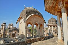 DUNDLOD, RAJASTHAN, INDIA - DECEMBER 27, 2017: General view of a well with turrets and cenotaphs and mural paintings in the foregr. General view of a well with Royalty Free Stock Photos
