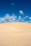 Dune and blue sky Stock Photos