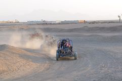 Dune Buggies racing in desert Royalty Free Stock Photography