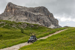 Dune buggy on a dirt road in Dolomites, Cinque Torri, Dolomites, 16 August 2015 Royalty Free Stock Image
