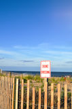 Dune Crossing Sign and Fence Royalty Free Stock Photo