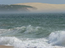 Dune du Pyla, La Teste de Buch (France). View of the Dune du Pyla, the highest in Europe, from Cap Ferret, a summer afternoon with heavy seas Royalty Free Stock Images