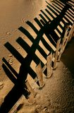 Dune fence. Abstract shadow of a dune fence in a sunset light royalty free stock images