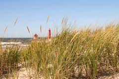 Dune Grass and Lighthouse. Sand Dune Grass with a Great Lakes Lighthouse in the Background Royalty Free Stock Image