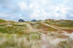 Dune landscape at the North Sea with holiday homes near Henne Strand, Jutland Denmark Scandinavia Europe. Dune landscape at the North Sea with holiday homes near royalty free stock photo