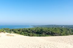 The dune of Pilat on the Arcachon Bay, France. The dune of Pilat, or Pyla, on the Arcachon Bay, is the highest sand dune in Europe. It is located a few Stock Photos