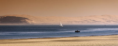 Dune of Pyla and sailing boat. Dune of pyla  in  the Basin of Arcachon Stock Images